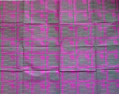 Large sheet pink tissue paper, linoprinted by hand with heart design