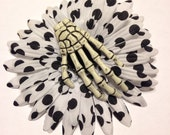 Polka dot flower with skeleton hand