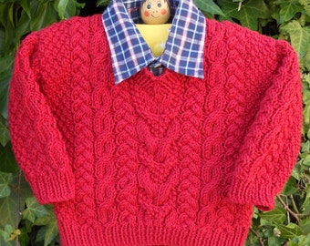 Sweater/jumper Aran style for a boy or girl, hand knitted in red cotton/bamboo yarn, age approx 3-6 months, chest 16-17 ins