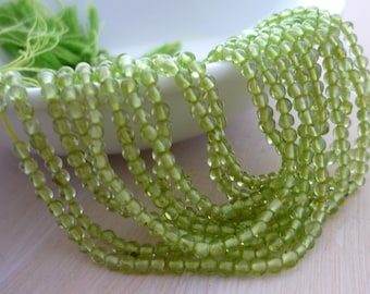 Smooth polished peridot round beads 1.5-2mm 1/2 strand