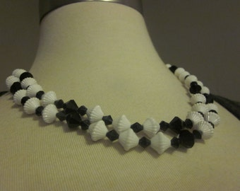 What's Black, White & Has a Gold Tone Flower Clasp - Vintage Double Strand Necklace