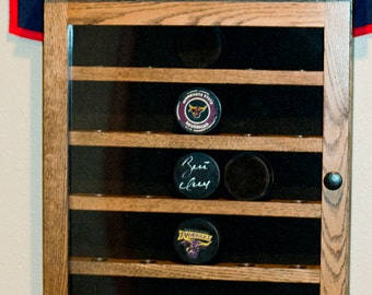 Hockey puck display cabinet  20 ,25,30or 35 pucks solid oak with door