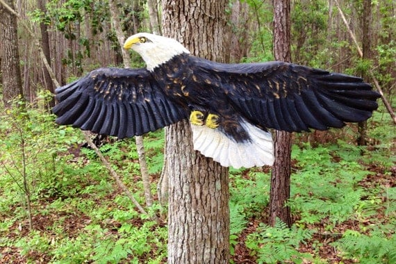 Flying bald eagle chainsaw wood carving
