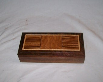 Handcrafted works of Art with a functional flair. Wooden trinket or keepsake box.