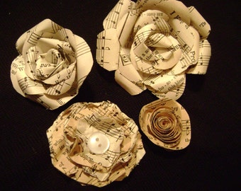 set of 4 aged vintage hymnal sheet music paper roses tea stained looking spiral realistic and lollipop