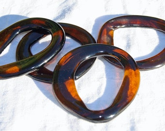 napkin rings made from brown recycled glass set of 4