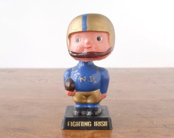 Notre Dame football bobblehead doll, Fighting Irish, vintage 1970s Hong Kong bobbin' head toy figure, blue gold plastic football player boy
