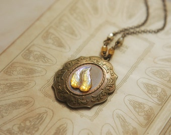 Vintage glowing yellow leaf necklace with amber glass beads in antique brass