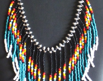 Native American necklace in teal, black, white, red orange and marigold