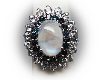 Sterling Silver Moonstone Cocktail Ring complimented by Blue Topaz, Diamond Simulants