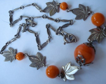 Art Deco Necklace Orange Glass Beads and Chrome Leaves and Caps  1920's 1930's Neiger Bros