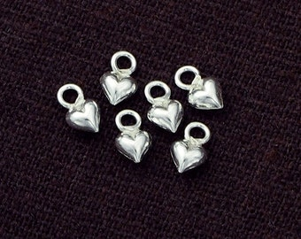 10 of 925 Sterling Silver Tiny Heart Charms 4 mm. :th2243