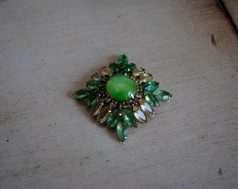 a vintage shades of green square jeweled brooch.