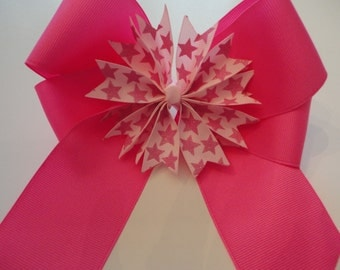 Hot Pink 6 inch wide Hair Bow with center piece that has sparkly stars