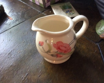 Vintage creamer with roses