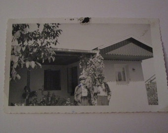 Vtg B&W photo of two older gentleman standing outside house, wearing hats. circa 1950s-60s