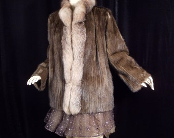 Price reduced ....Beautiful Gorgeous Natural Raccoon Paw Jacket 1980's