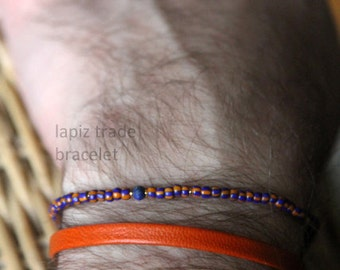 lapiz trade bracelet for men - mens orange and blue small bead bracelet with a blue gem and gold center - Maria Helena Design
