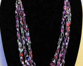 Three Strand Ladder Yarn Adjustable Necklace in Pinks/Red/Green