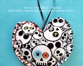 Hand Stitched Skull Fabric Heart Ornament. Blue and orange buttons, with blue and orange embroidery floss stitching. Black felt back.