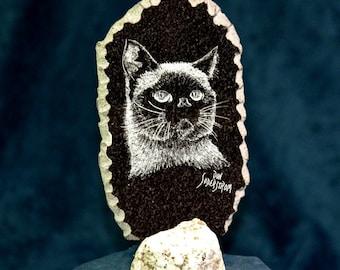 Custom etched pet portraits on black granite tile