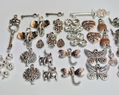 Tibetan silver charms, a great assorted collection, lots of great figures. New, 44 pieces
