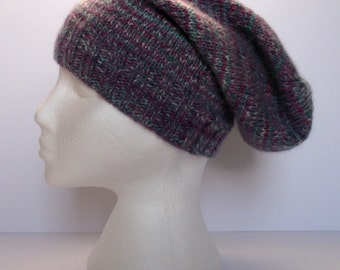 Women's hand knitted super slouchy beanie hat. Adult or teenager. Multicoloured.