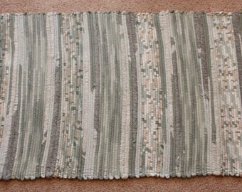 Handwoven Rag Rug - green & earthtones that make fun textured stripes  - 45 inches....(#66)