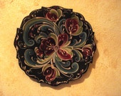 Black Fancy Edge Rosemaled 6 1/2 inch plate in Red, Blue and Green