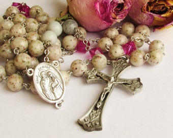 Custom keepsake Rosaries made with your dried flowers, ashes or fabrics from a funeral, wedding, baptism, Christening.  Special prayer beads