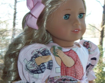 American Girl Doll  or 18 inch doll dress and hair clip..  Pink paper doll print dress.