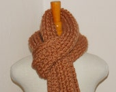 Burnt orange knit scarf.  Pumpkin colored neckwarmer.