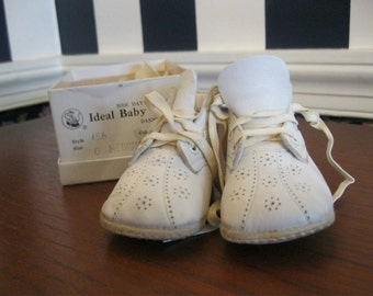 """Pair of white """"Ideal Baby Shoes"""", size 0 medium"""