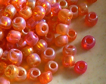 8/0 Glass Transparent Orange Rainbow Seed Beads - Item # ORB80A