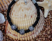 Black Leather Kumihimo Bracelet with 3 silver swirl accent beads