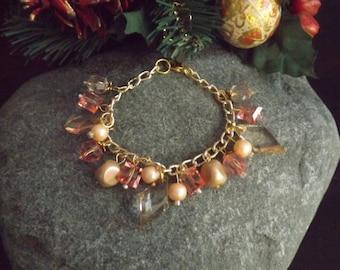 Pink/Beige Charm Style Bracelet