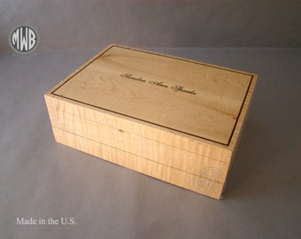 Larger than usual jewelry box of fiddle back maple.  Inlaid name and border.