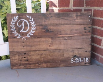 Pallet wood guest book sign with vine inital. Rustic alternative wedding.