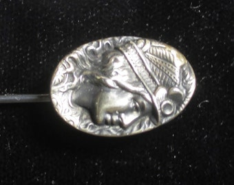 Antique sterling silver stick pin with cameo motif