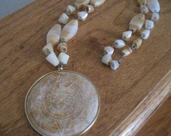 Vintage quartz medallion necklace.  Collectible.  Beaded.
