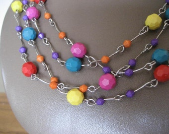 Vintage flapper necklace.  Faceted multi color beads.   64 inches.  Sale.