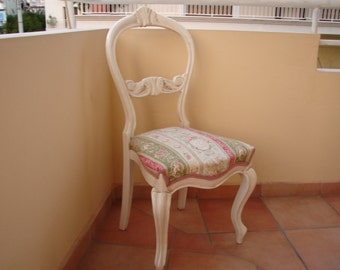 original 1880's child's ? Victorian balloon back chair with carved acanthus leaves design & cherubs fabric.