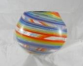 Handblown clear spherical glass bowl with rainbowl swirls