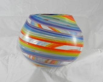 Handblown clear spherical glass bowl with rainbowl swirls