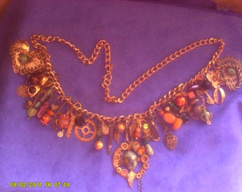 whimsical Steampunk Necklace handcrafted  many,vintage pieces, of jewelry.gears ,stones...
