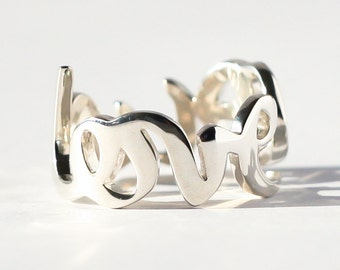 ONELOVE ring, sterling silver, can be individualized with the name, Word or string of your choice. Make your desired word ring from it!