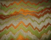 Vintage metallic brocade fabric. - Flamestitch zig zag pattern - Gold, Lime green , orange and white