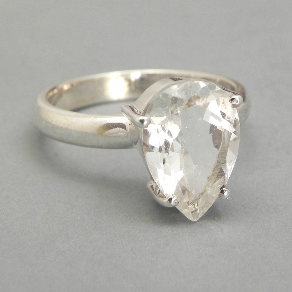 sterling silver ring set with white topaz pear shaped