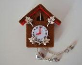 Brown Cuckoo clock brooch