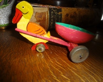Too cute wood duck with paper mache egg cart...very collectible